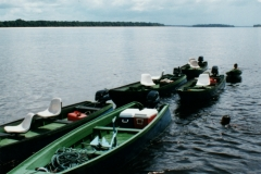rio_negro_guide_boats_in_tow_behind_peacock_nexus